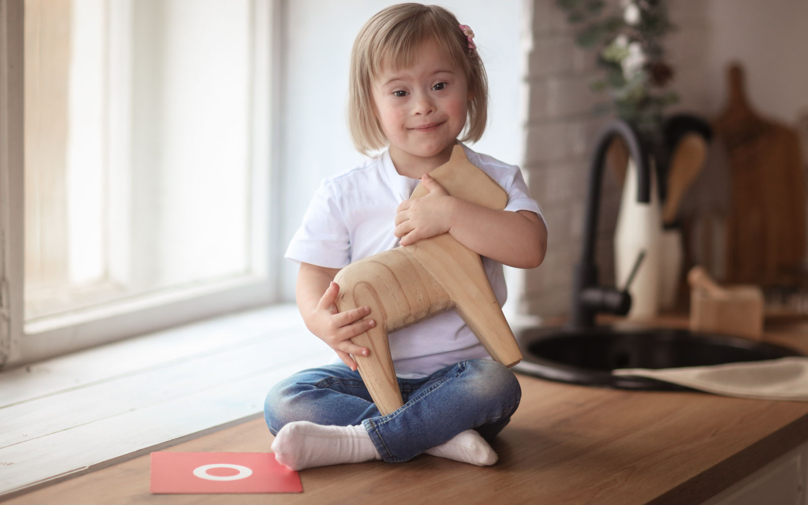 Just ONE Health and Social Care | Providing Care, Support & Accomodation | Child with wooden horse