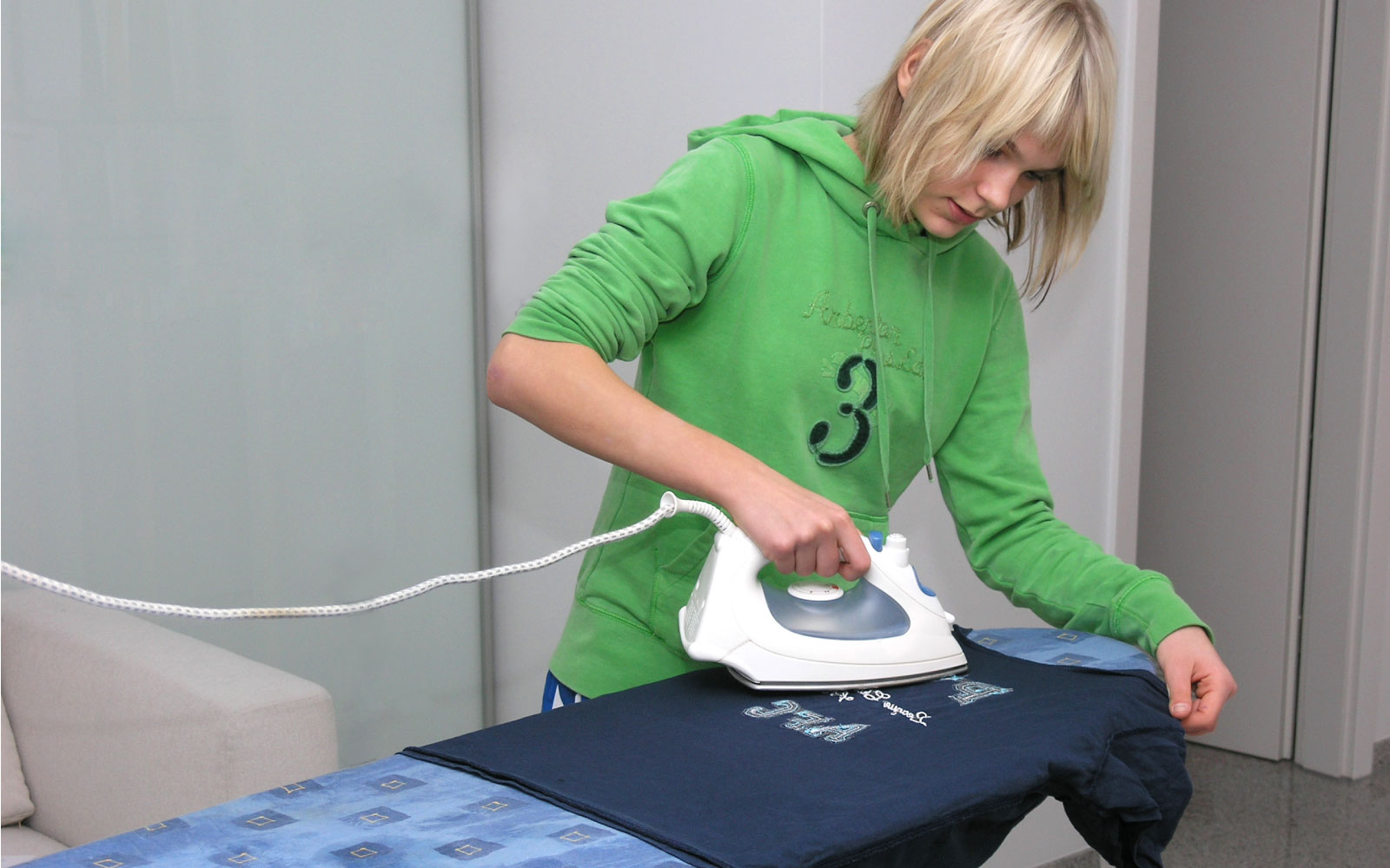 Just ONE Health and Social Care | Providing Care, Support & Accomodation | Ironing teenager